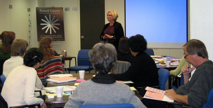 Dr. Margaret Holt leads a deliberative dialog training session at the Russell Library.