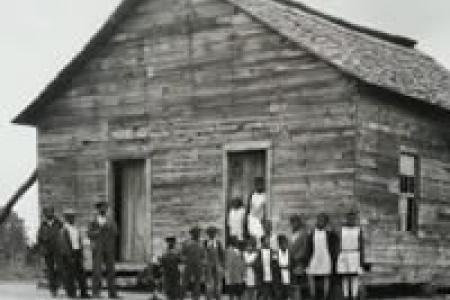 Exterior of a rural schoolhouse for Black children, photo by Horace Mann Bond